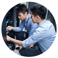 Two IT engineers working in data center