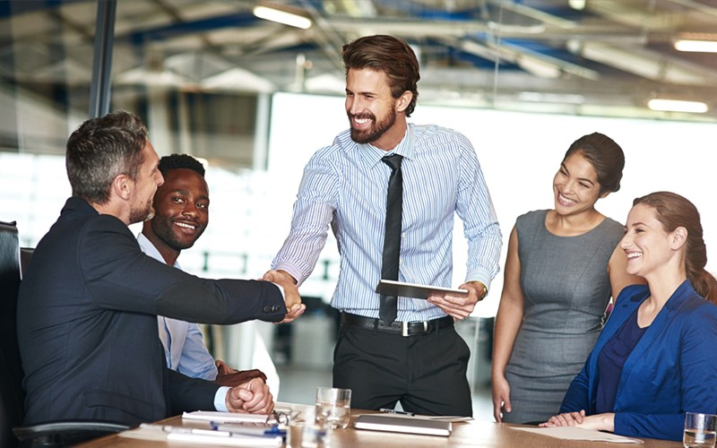 Businessman closing the deal with partners in meeting