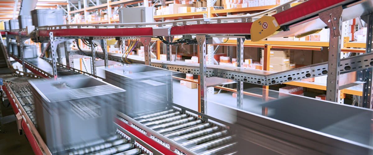 boxes moving through automated supply chain in factory