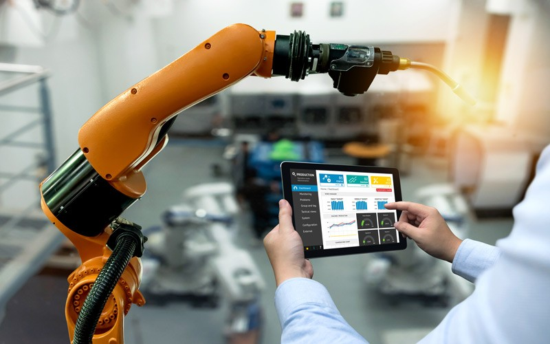 Male working from iPad to control manufacturing system
