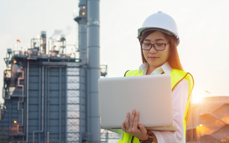 Business professional using laptop on site